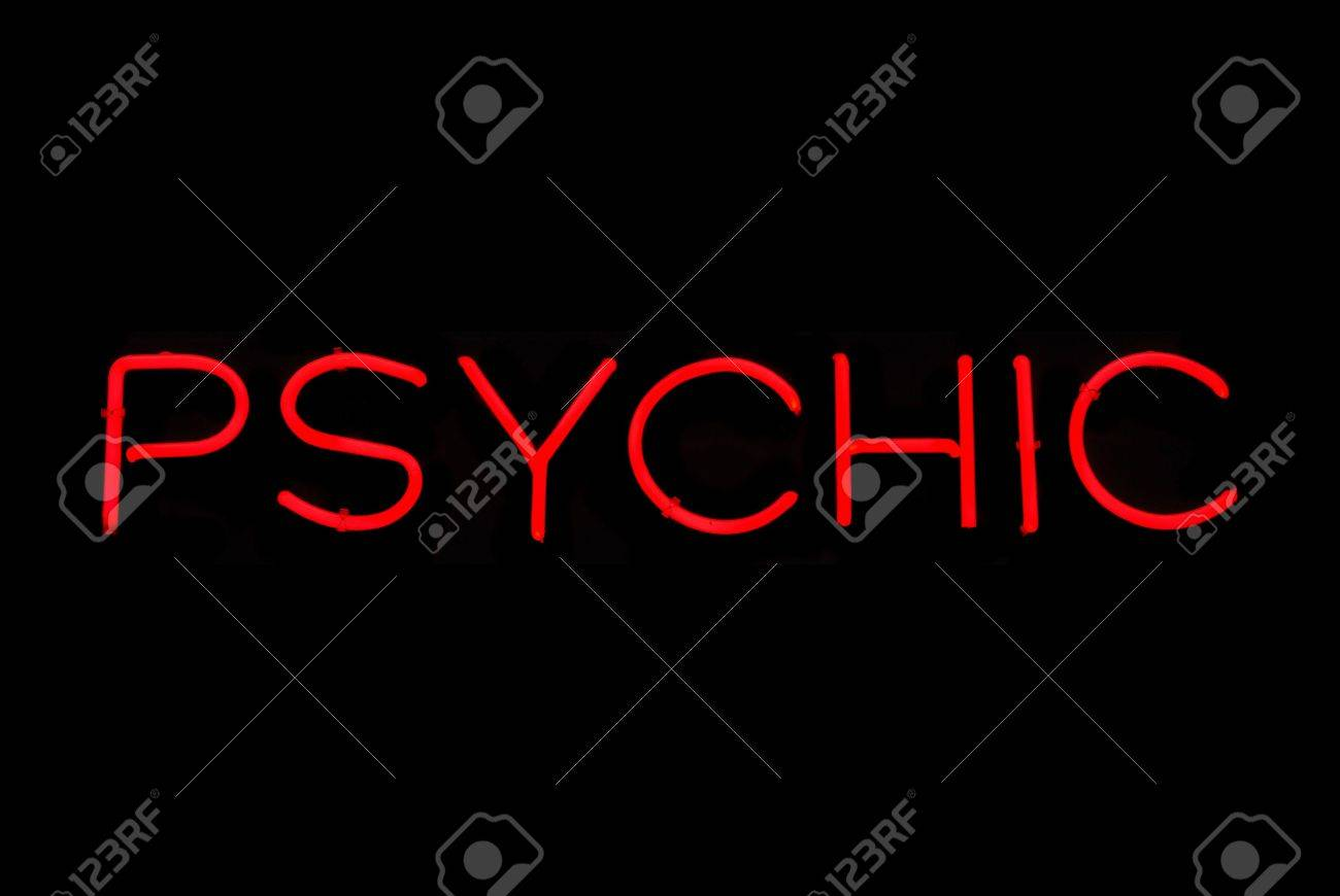 Illuminated red psychic neon sign on black Stock Photo - 2142540
