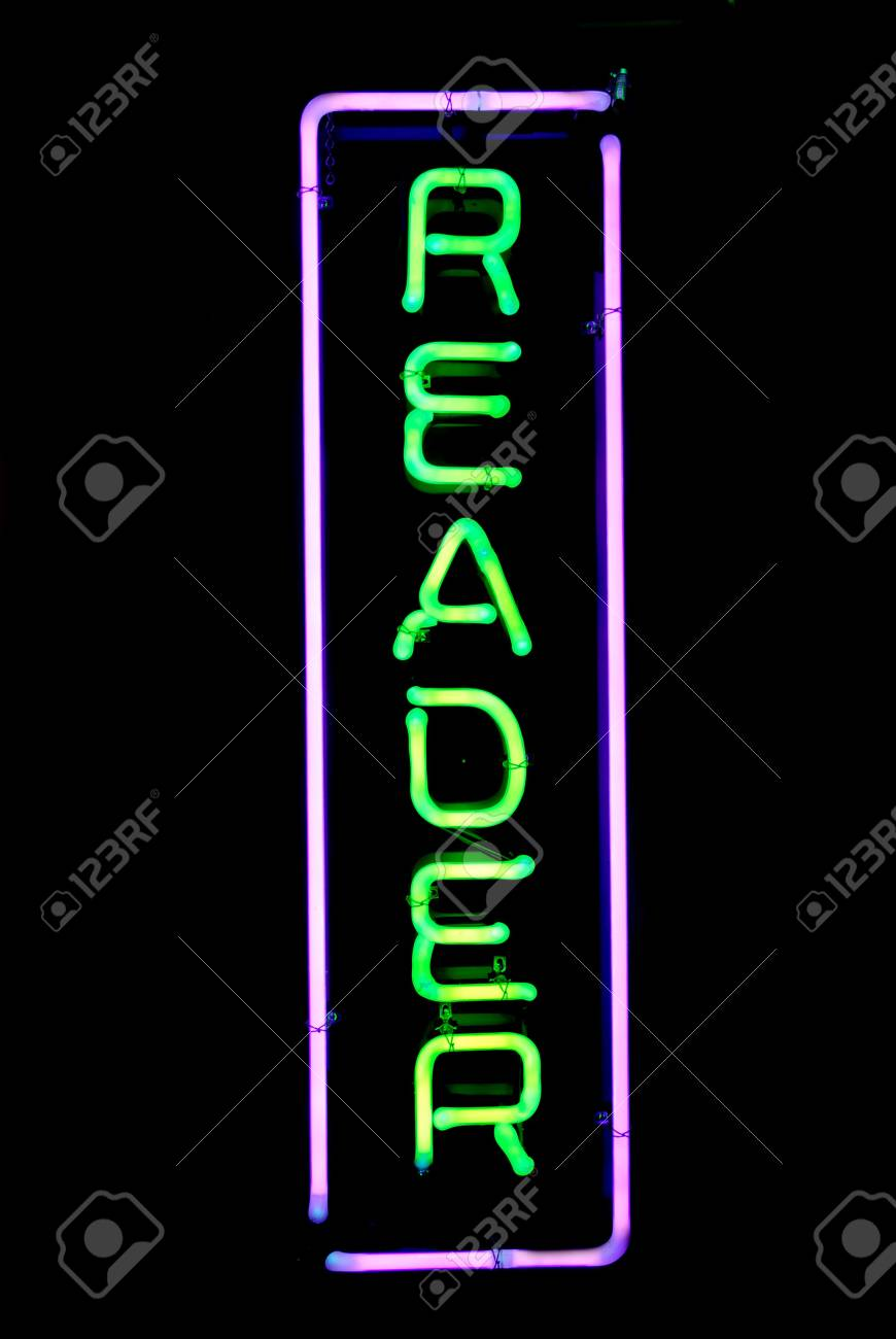 Green and purple reader neon sign Stock Photo - 3339642