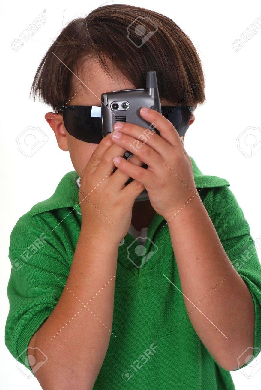 Boy hiding behind a cell phone