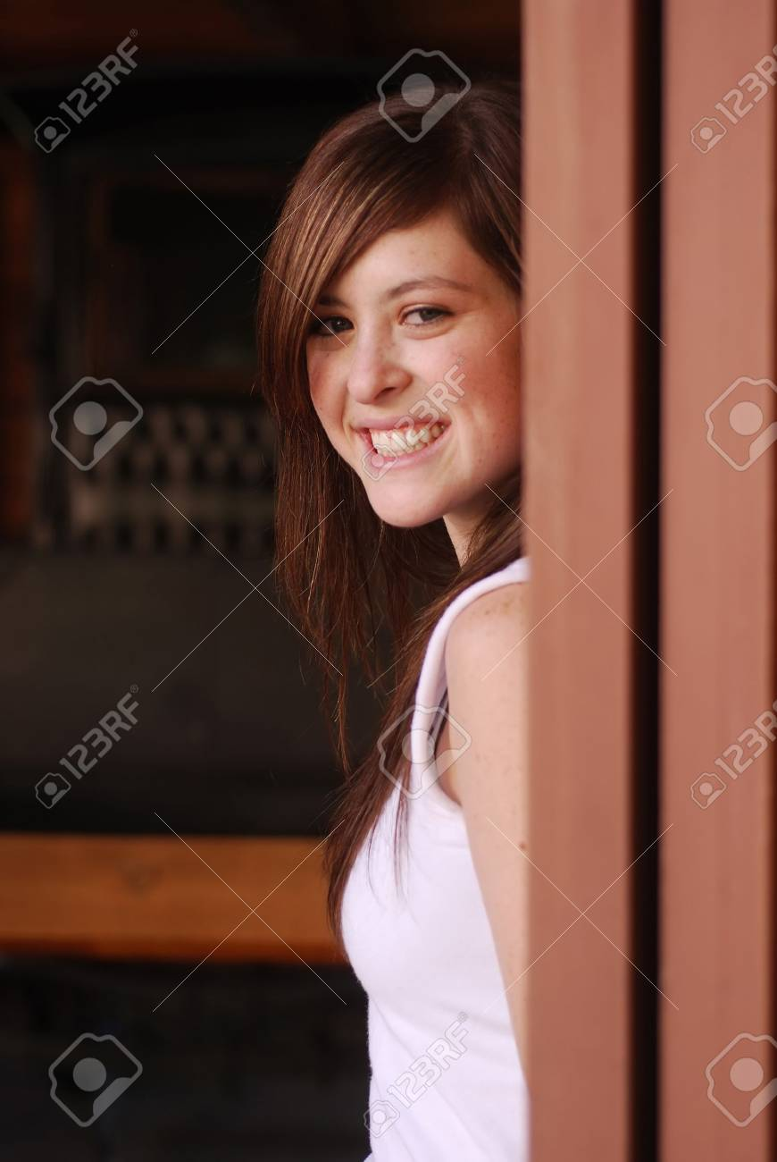 Young adult brunette woman inside a stable on a country farm Stock Photo - 3654744