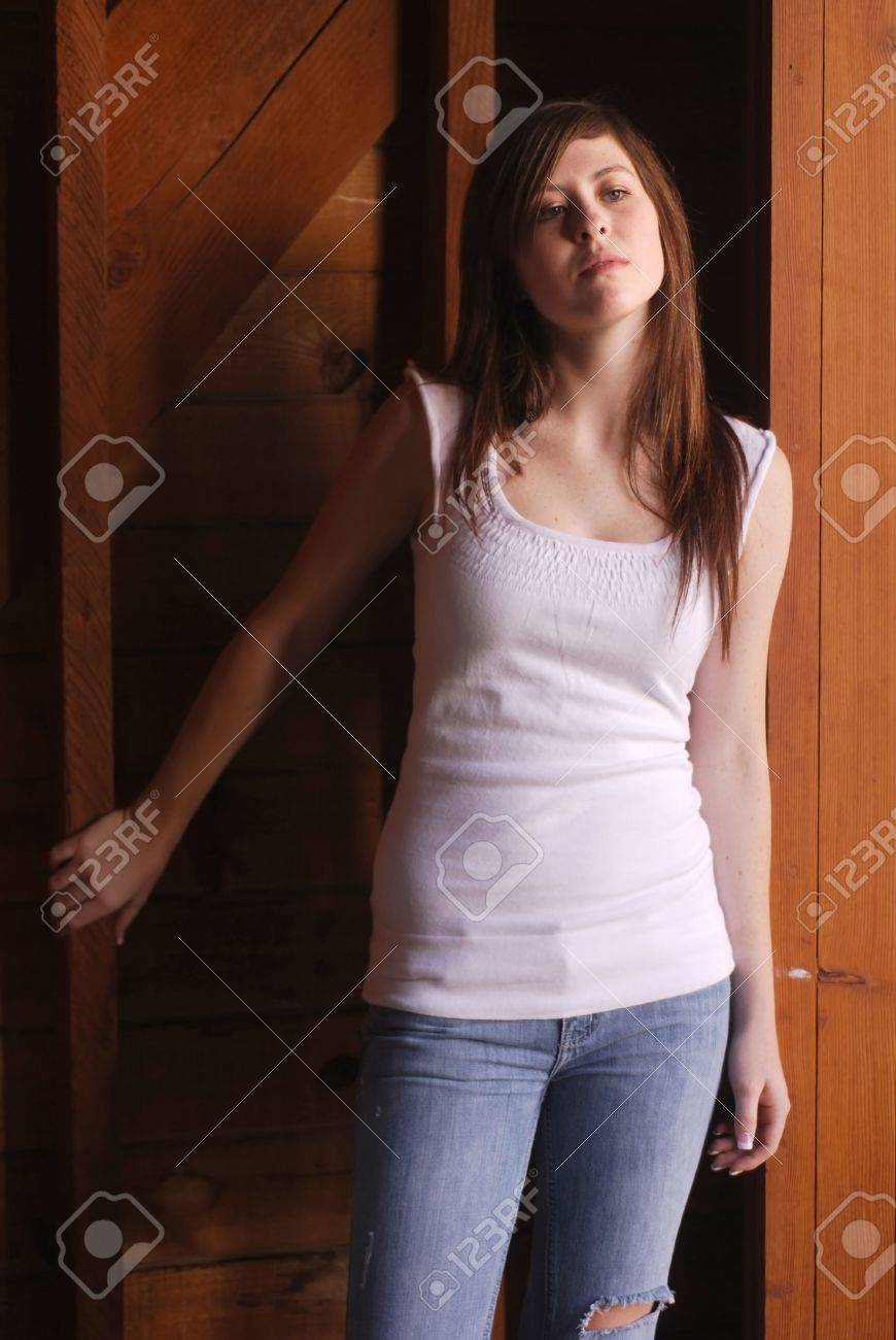 Young adult brunette woman inside a stable on a country farm Stock Photo - 3654759
