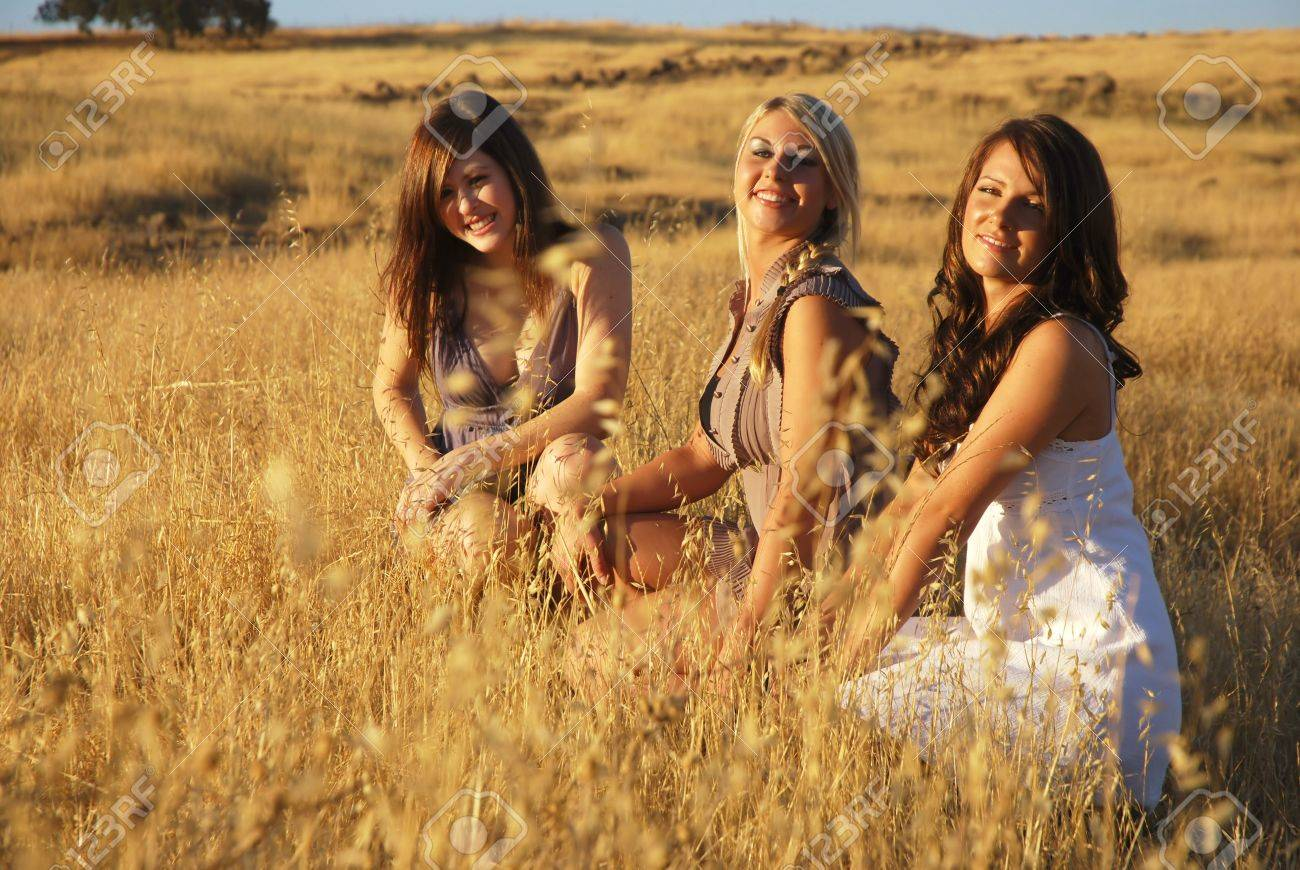 Young women in a dried grassy meadow Stock Photo - 3654767