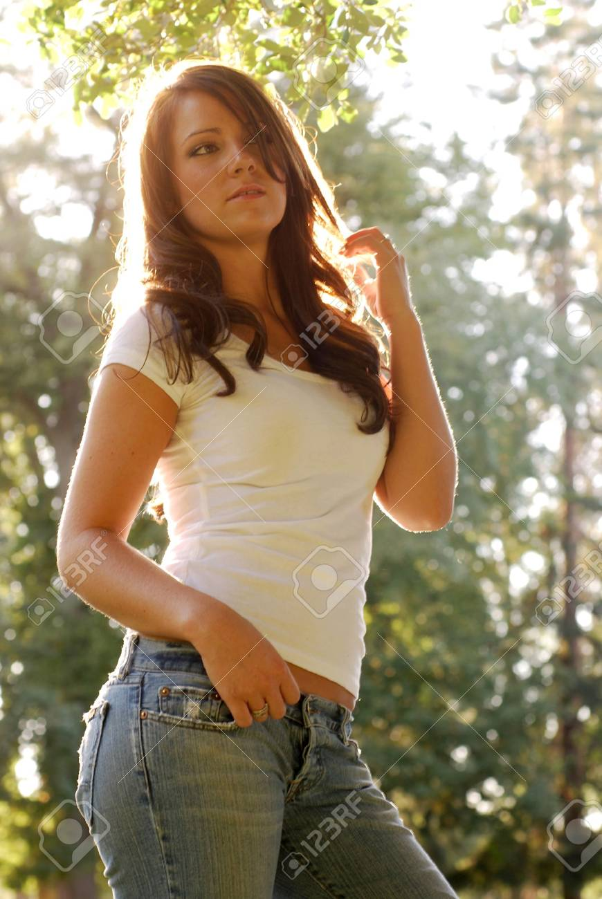 Young adult brunette woman in the countryside Stock Photo - 4857153