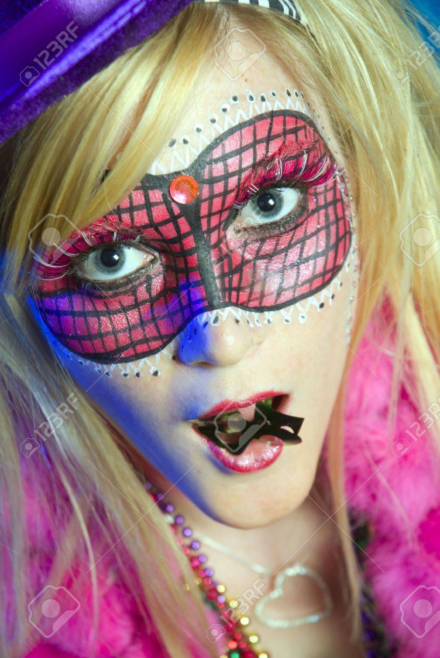Blonde woman dressed up for Mardi Gras party Stock Photo - 5760376