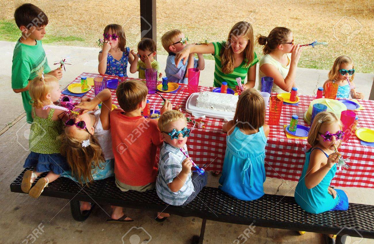Kids at an outdoor birthday party and picnic Stock Photo - 7664690
