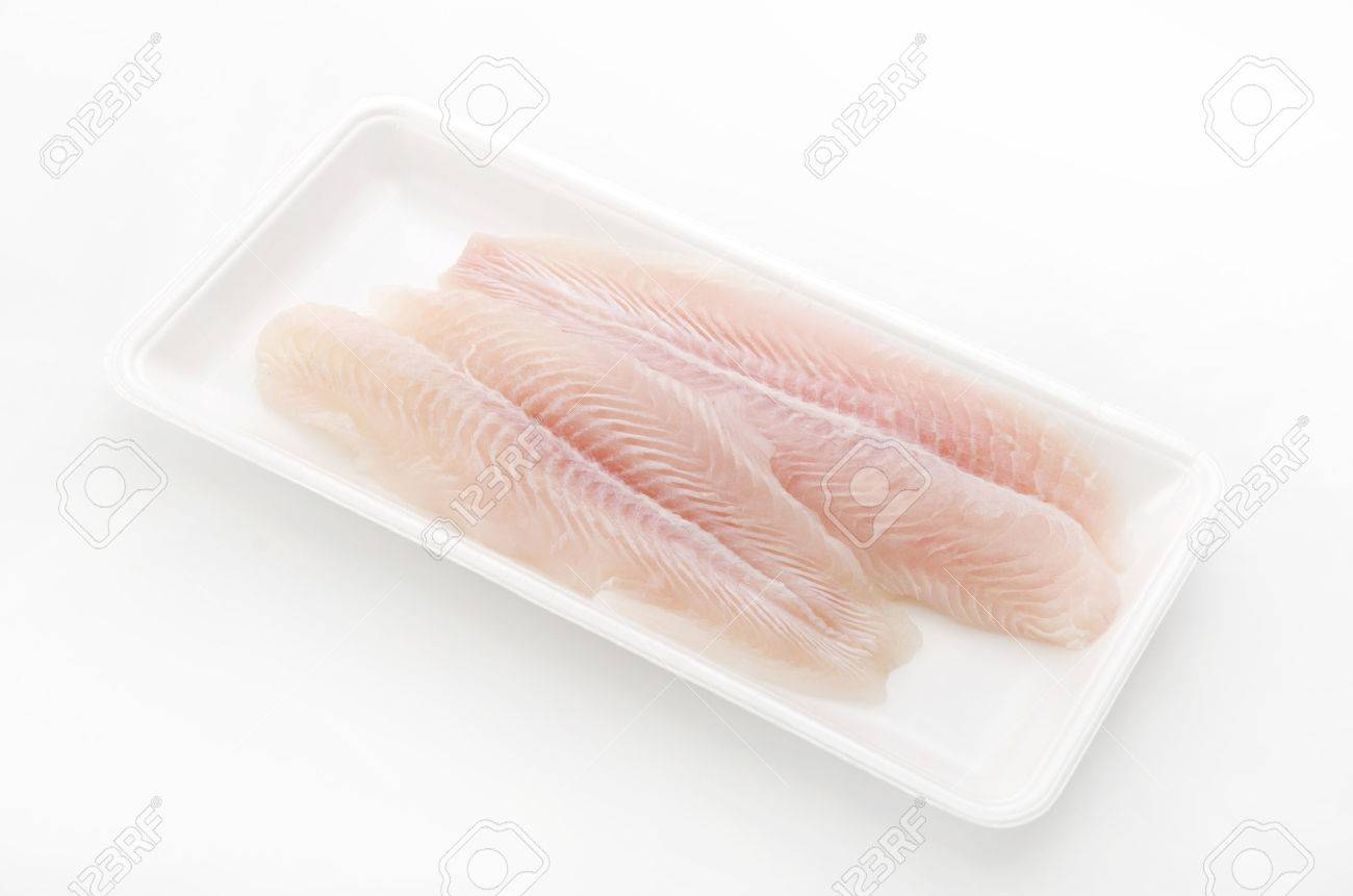 Fillet of Fish Pangasius. Isolated on white background. - 62052477