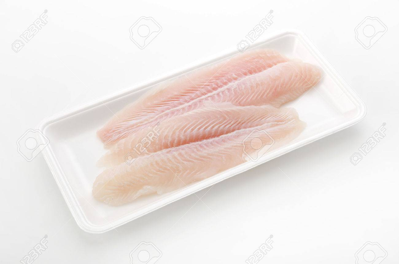Fillet of Fish Pangasius. Isolated on white background. - 62052479