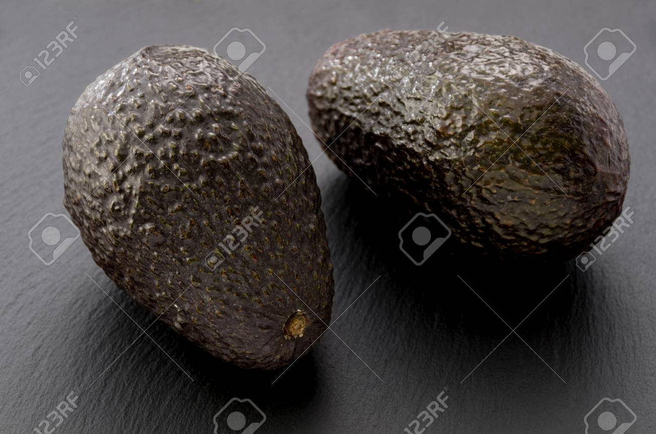avocado on black stone plate stock photo picture and royalty free