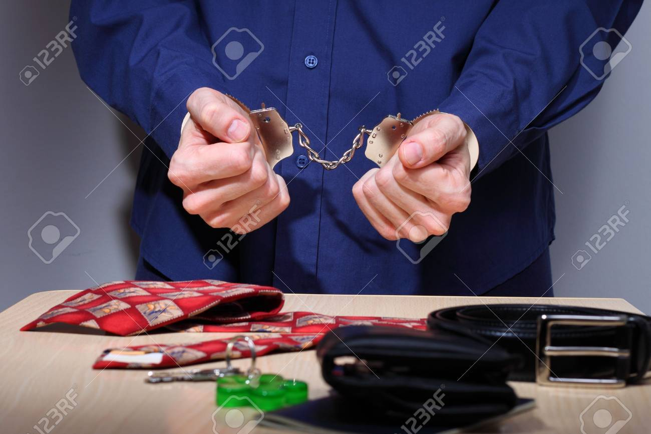 Businessman with handcuffs, stripped of personal items during arrest Stock Photo - 6782802