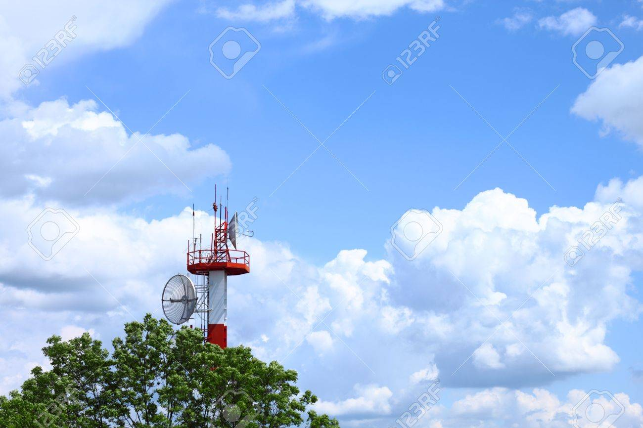 Air traffic control communications tower against cloudy blue sky, symbolic background Stock Photo - 6992403
