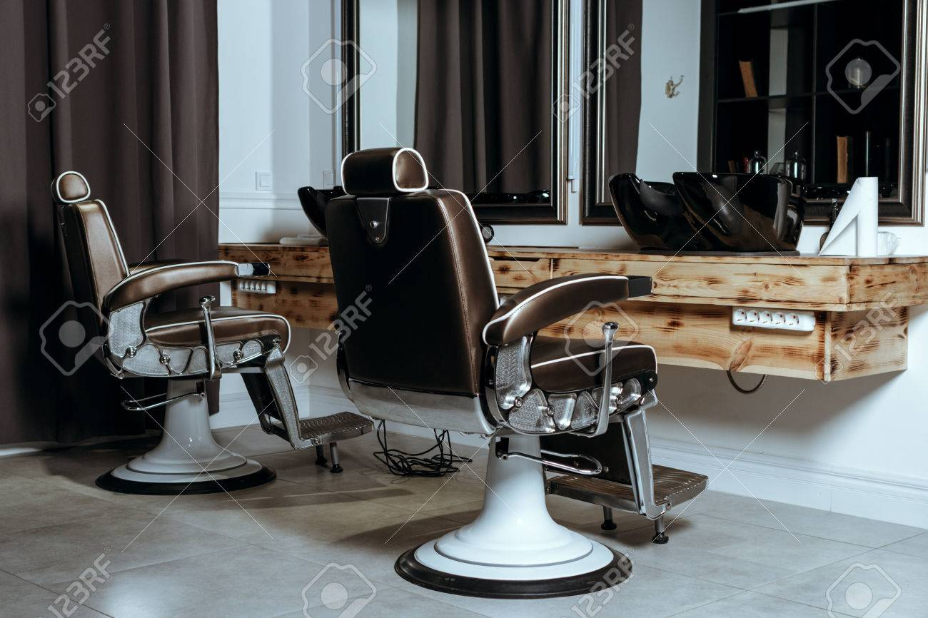 Stock Photo   Stylish Vintage Barber Chairs In Wooden Interior. Barbershop  Theme