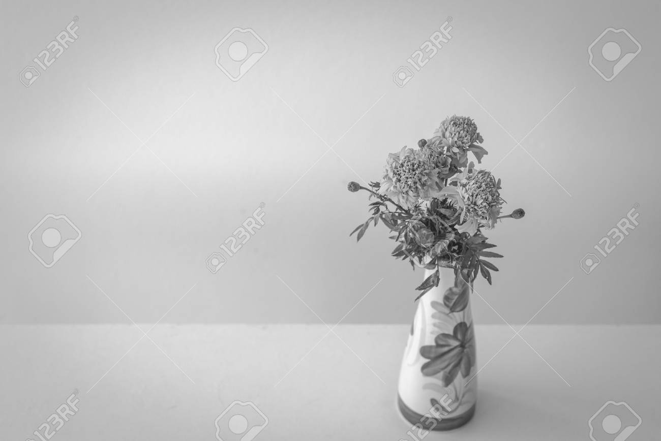 Marigold artificial flowers in white ceramic vase black and marigold artificial flowers in white ceramic vase black and white stock photo 47360297 mightylinksfo