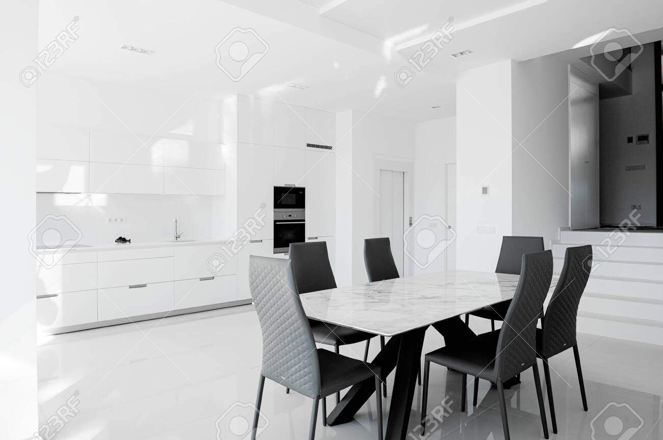 Luxurious Modern Dining Room With White Table Black Chairs And Stock Photo Picture And Royalty Free Image Image 147457992