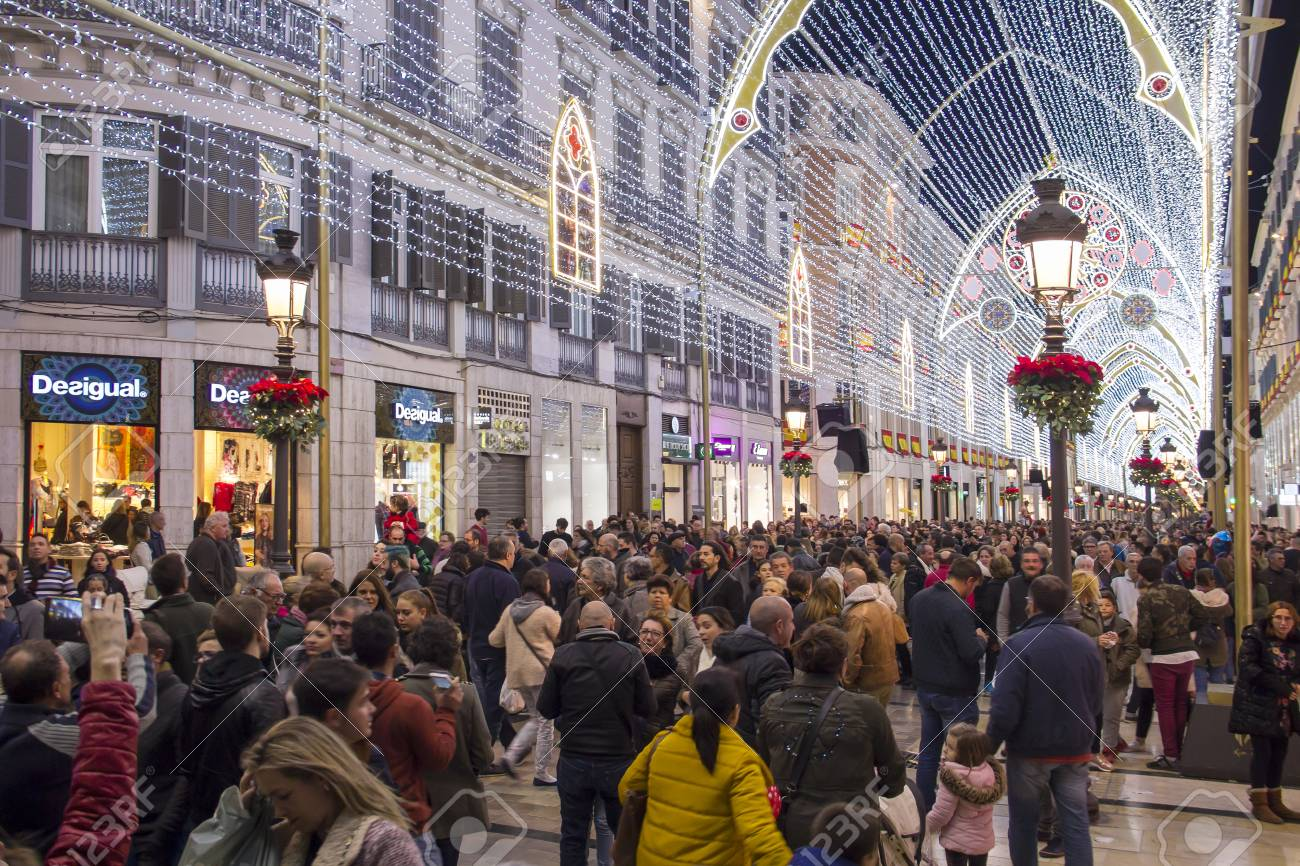 MALAGA, SPAIN - DECEMBER 9, 2017: Christmas decorations and light show in the center of Malaga (Calle Marques de Larios walking street) - 104985197