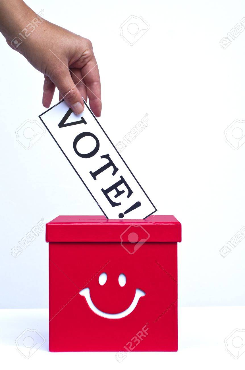 Hand putting a voting ballot in a slot of box Stock Photo - 15818052