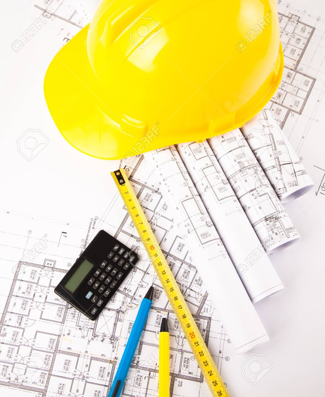 Photo Of Hardhat Calculator And Measure On Blue Print Stock Photo