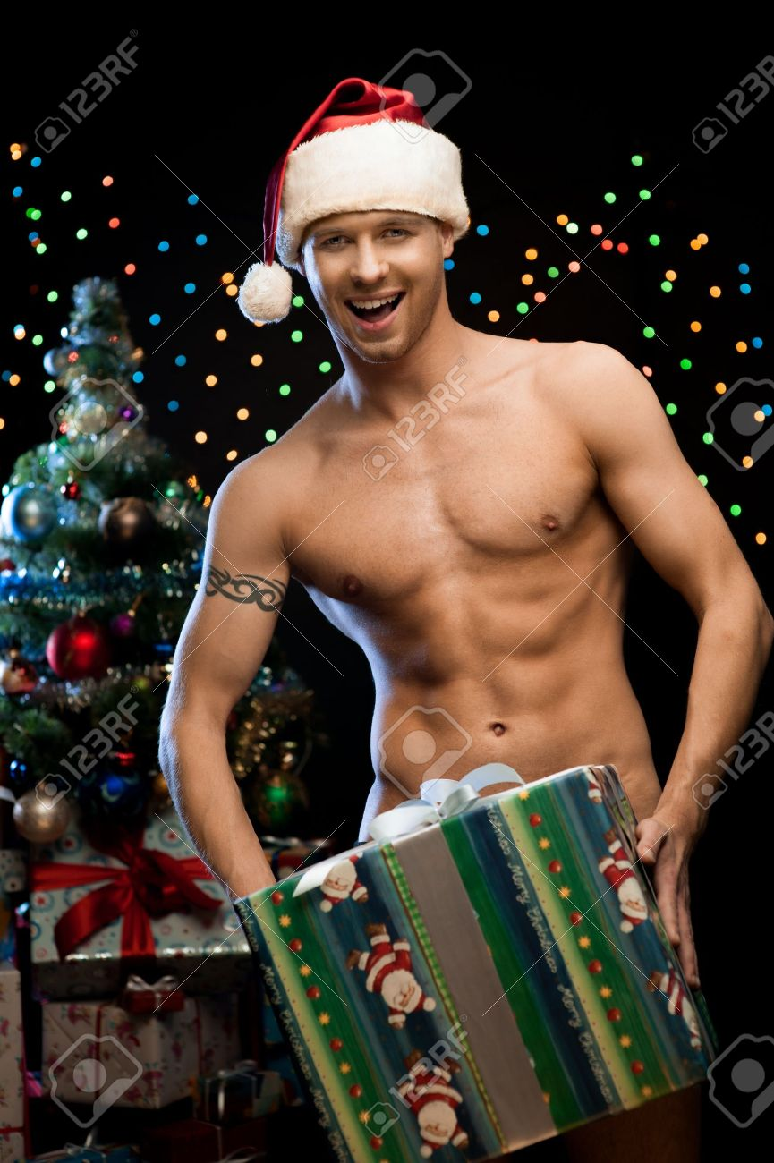 Young Naked Man In Santa Hat Holding Big Christmas Gift Over ...