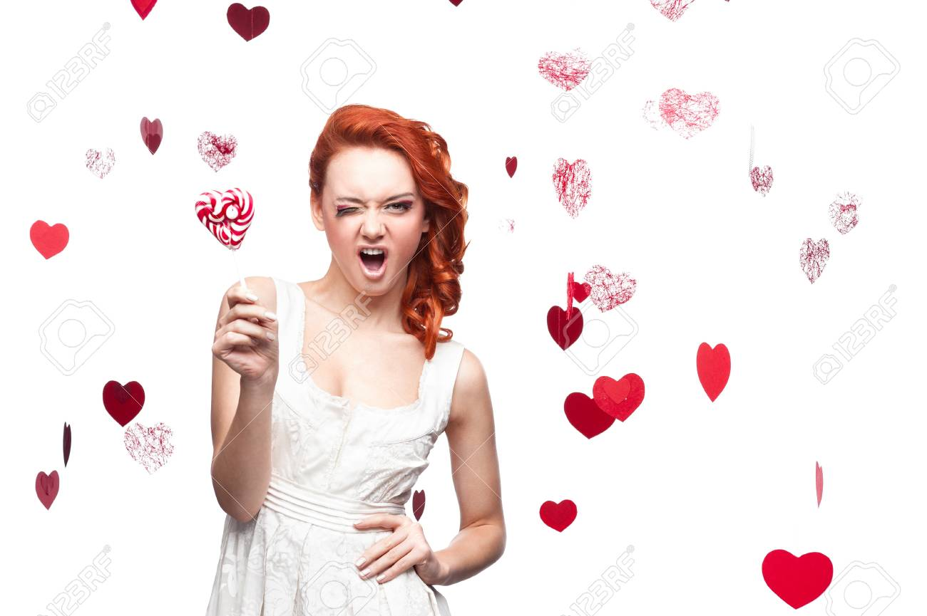 young cheerful caucasian red-haired woman holding lollipop Stock Photo - 16311917