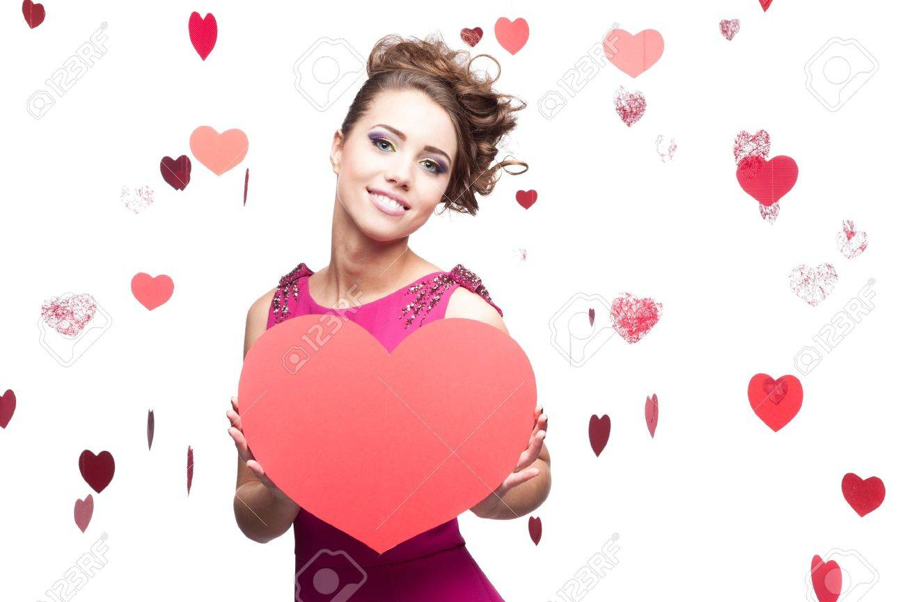 young cheerful caucasian brunette woman holding big red paper heart - 16518949
