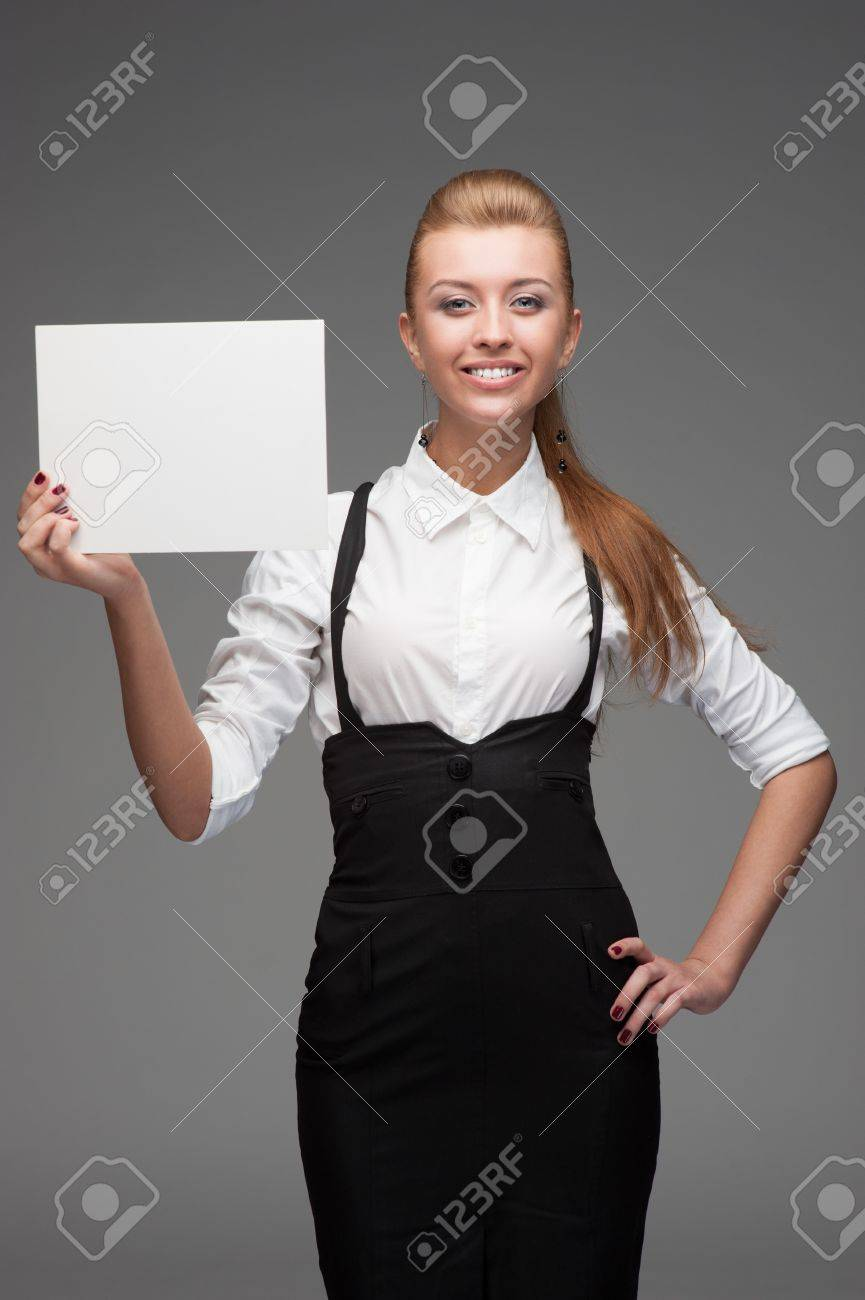 young cheerful caucasian businesswoman holding sign isolated on white Stock Photo - 17891128
