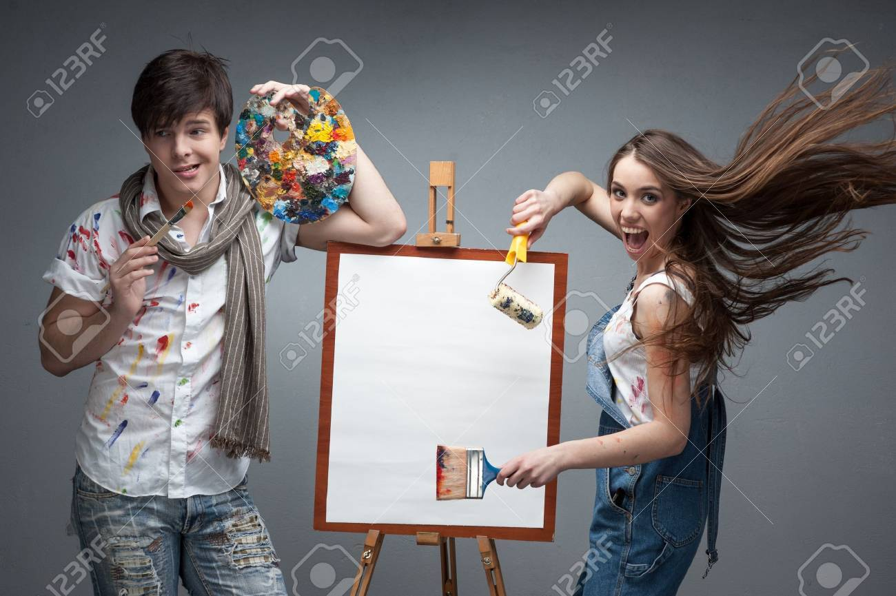 man and woman painters emotionally discussing art project - 20598256
