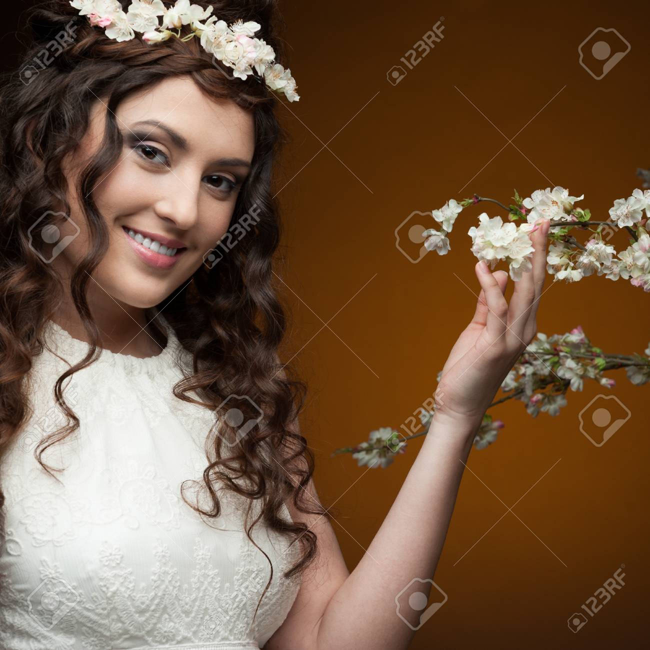 Young Smiling Brunette Woman In Long White Dress And Flowers Stock