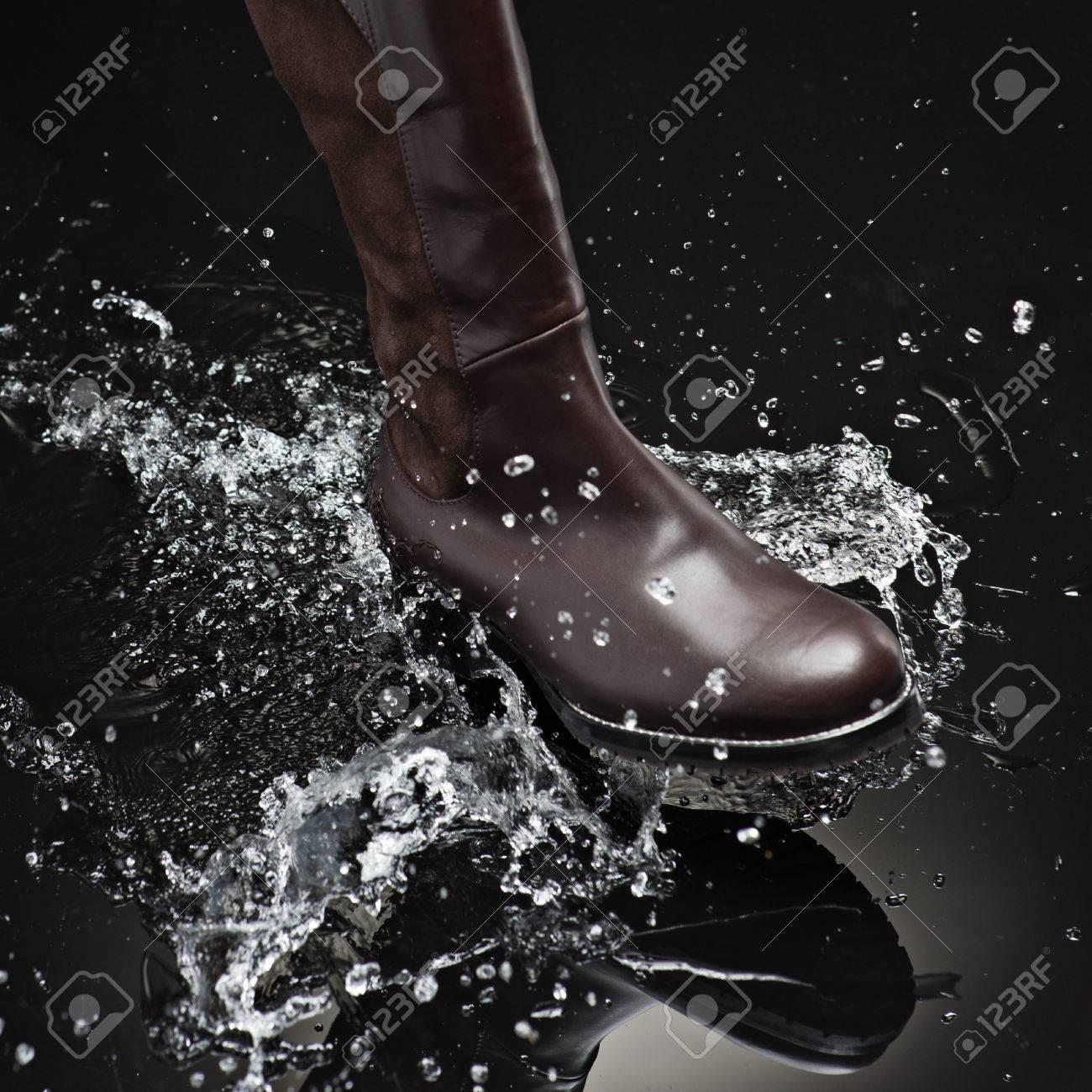 brown leather female boot splashing water - 31032507