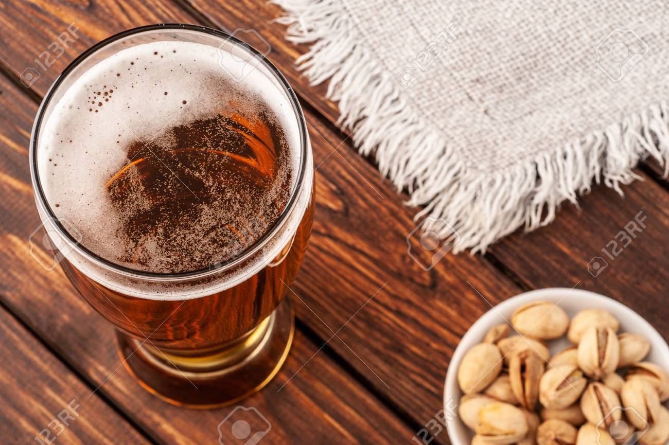 Composition with glass of beer on wooden background. Closeup. - 118498309