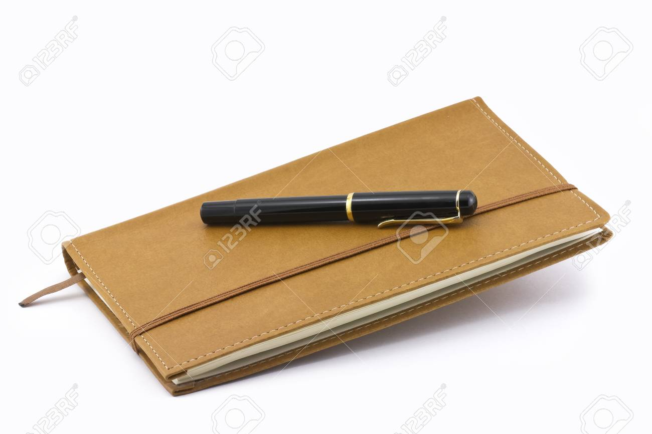 Leather notebook and pen isolated on the white background Stock Photo - 12756100