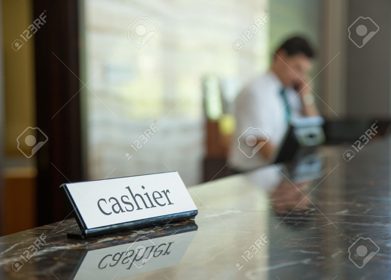 Hotel reception desk with a cashier table and receptionist on a background Stock Photo - 18310708