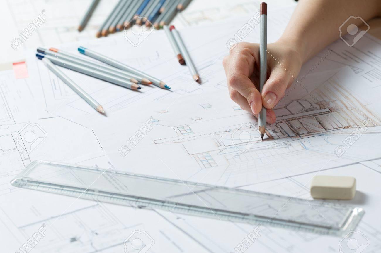 Interior Designer Works On Hand Drawing Sketch Using olor ... - ^