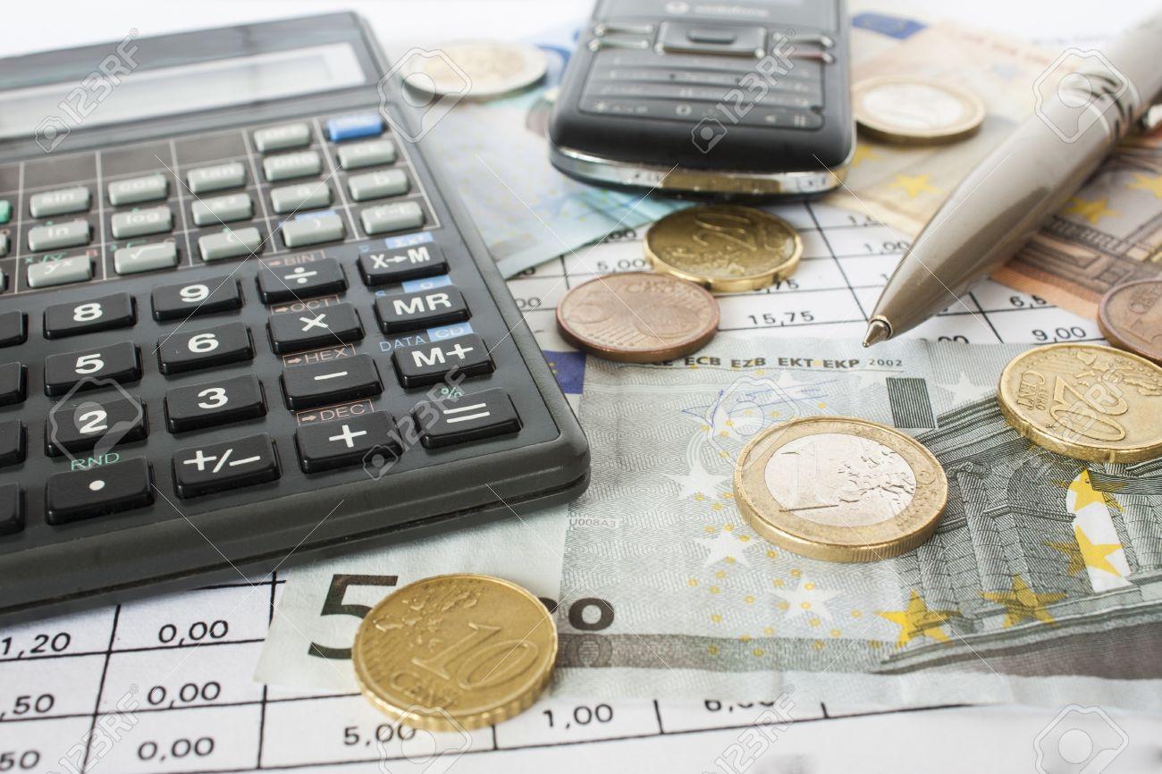 Money, bills and calculator,accounting Stock Photo - 16030186