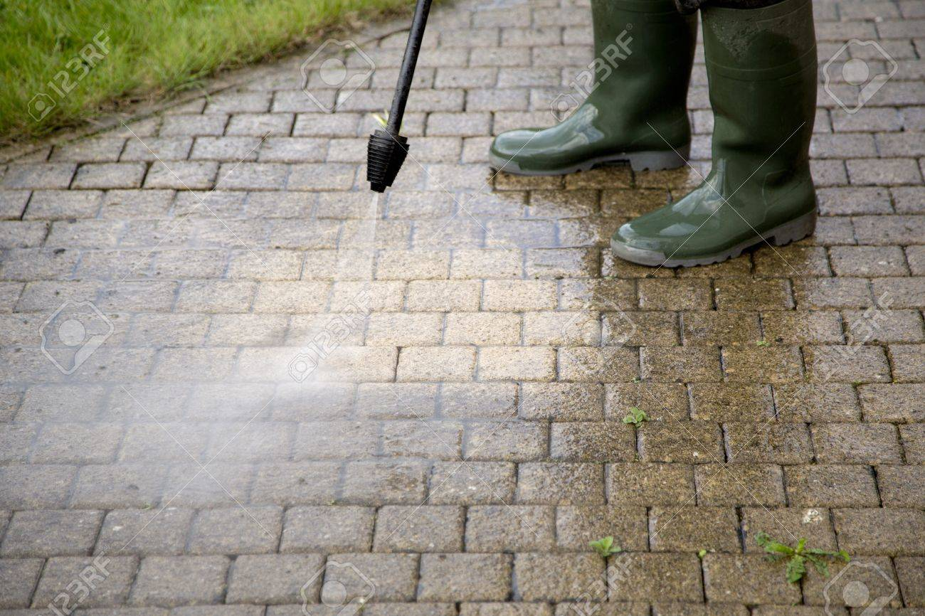 Outdoor floor cleaning with high pressure water jet Stock Photo - 20831080