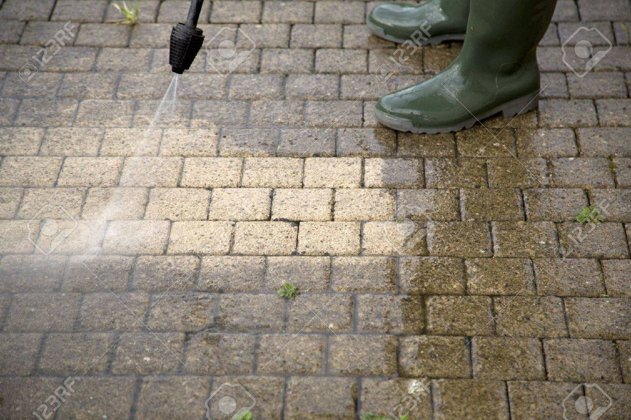 Outdoor floor cleaning with high pressure water jet Stock Photo - 20831082