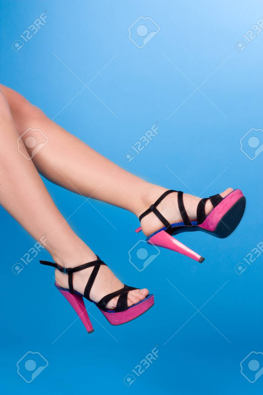 Woman legs isolated on blue background Stock Photo - 12903458