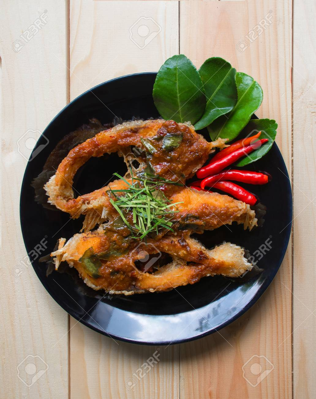 Fried Fish With Chili Sauce On A Black Plate Thai Food Style Stock Photo Picture And Royalty Free Image Image 50507398