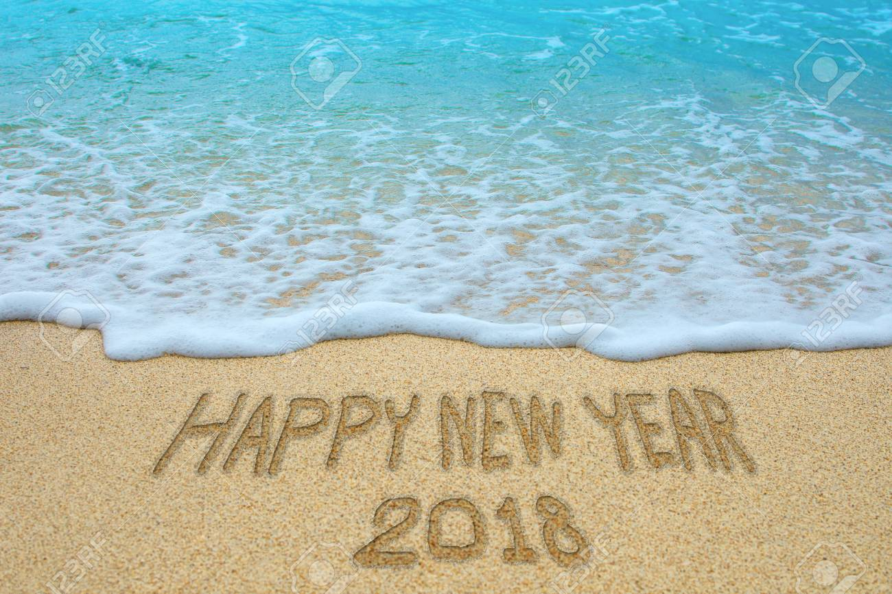 happy new year 2018 written on sandy beach new year 2018 is coming concept