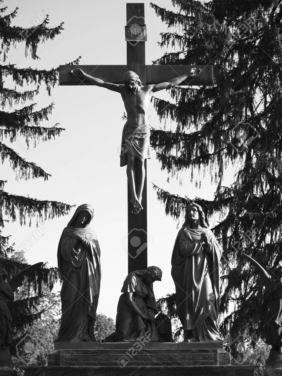 jesus on cross with mary and mourners black and white stock photo