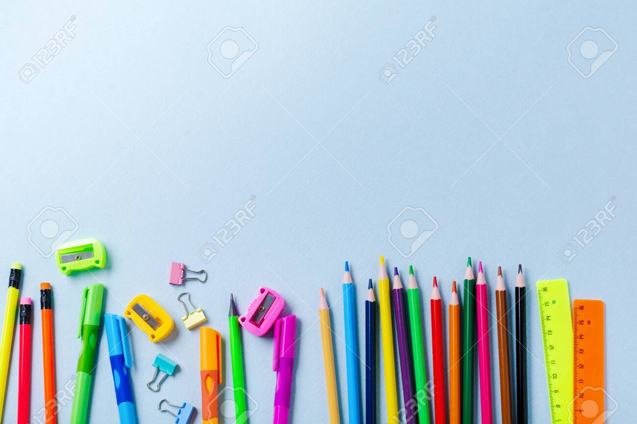 Notebook, colored pencils, ruler, pen, eraser, sharpener and more. School and office stationery on blue background. Concept back to school. Top view. - 125860279