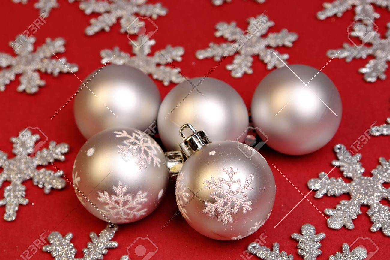 Silver and red christmas decorations - Silver Christmas Ornaments On Red Stock Photo 631409