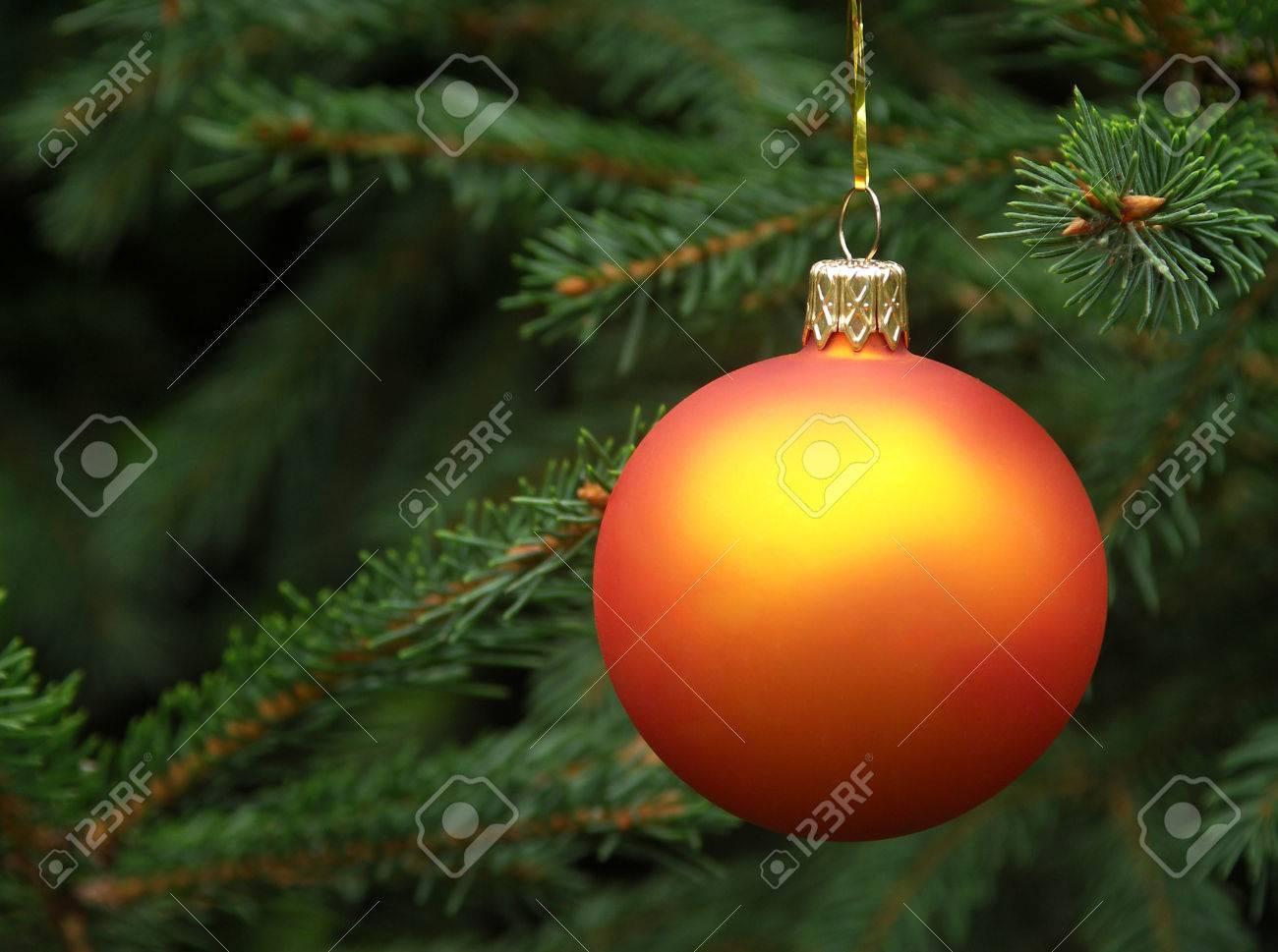 Orange Christmas Ball Hanging On A Christmas Tree Stock Photo ...