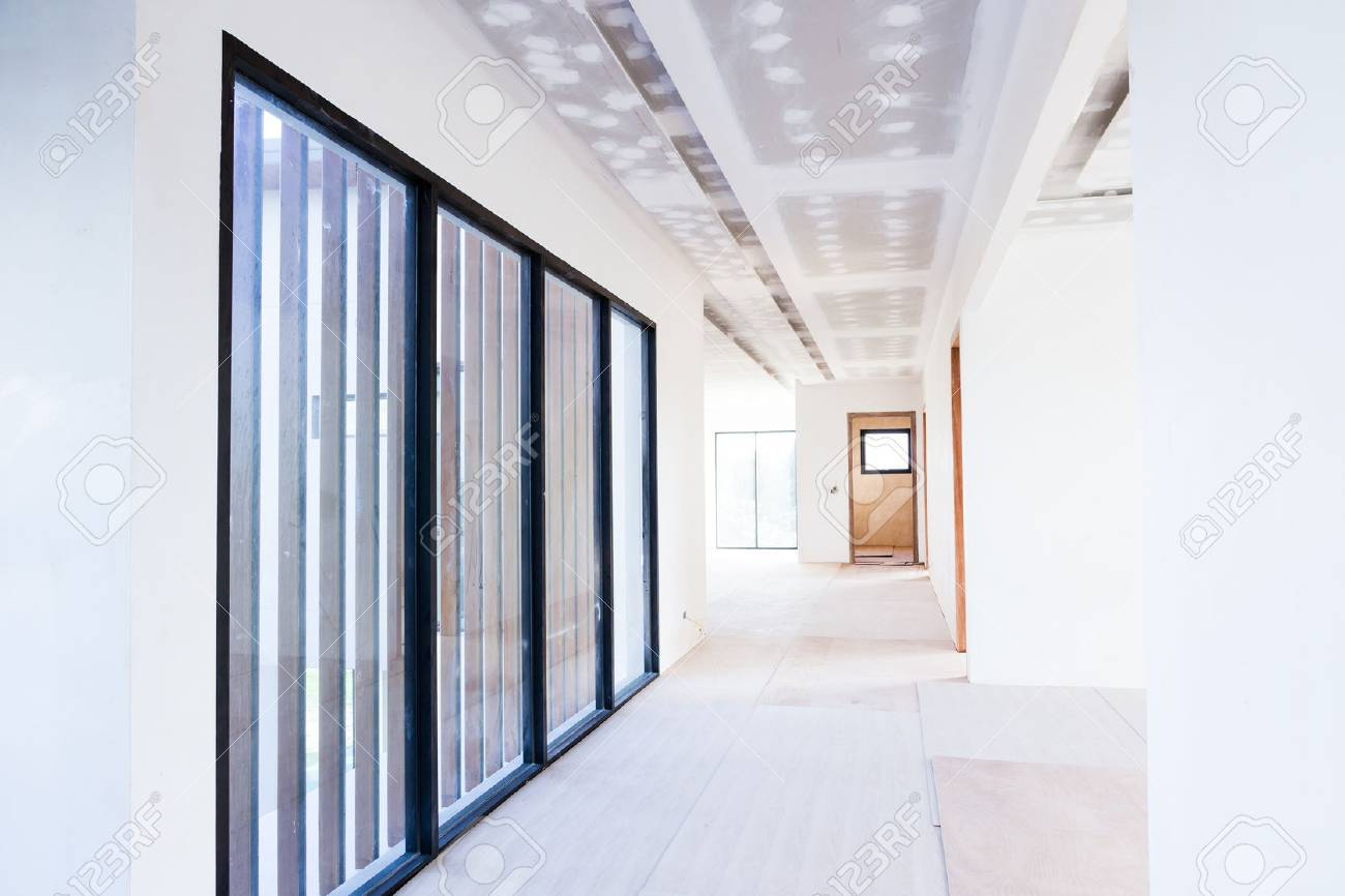 Empty room interior build gypsum board ceiling and Air conditioner in construction site - 65983397