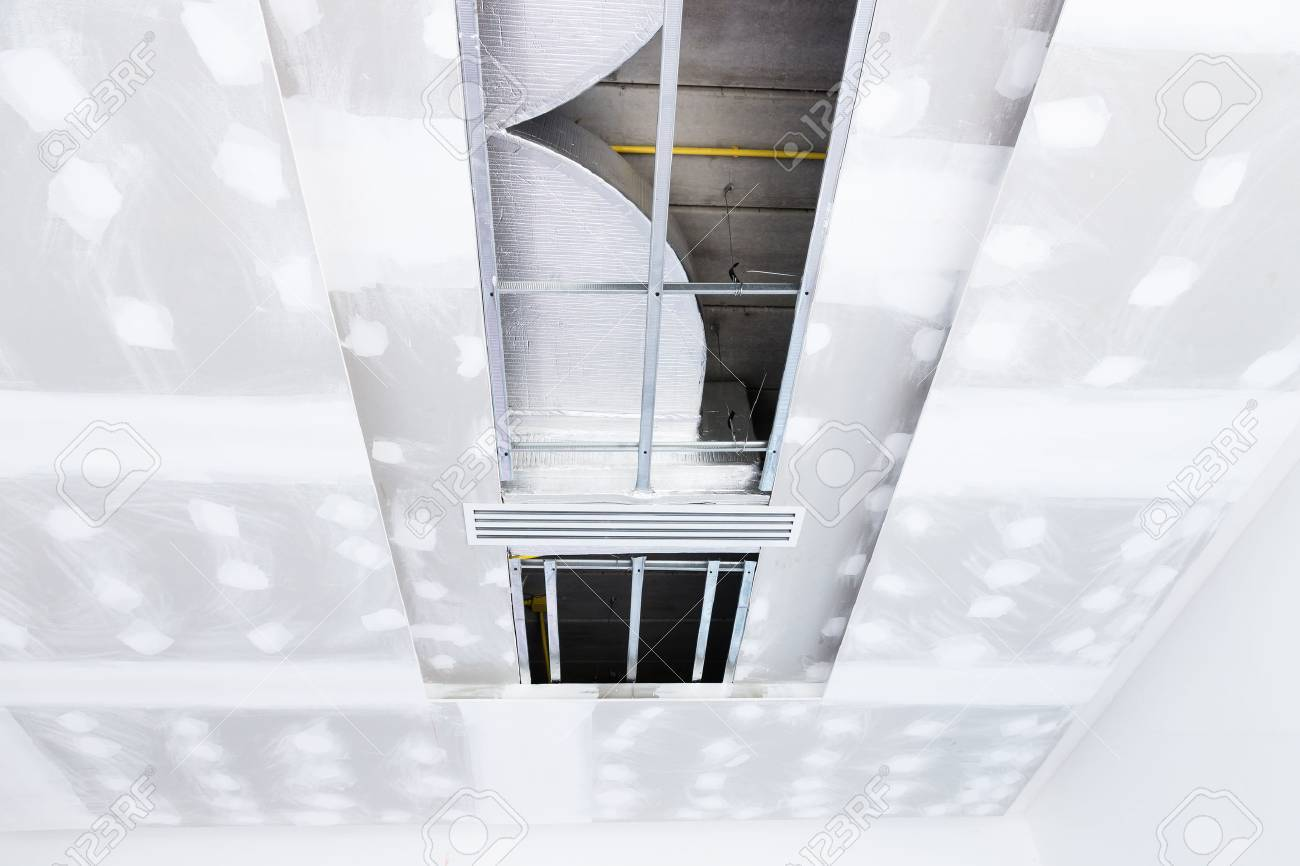 Empty room interior build gypsum board ceiling and Air conditioner in construction site - 65983421