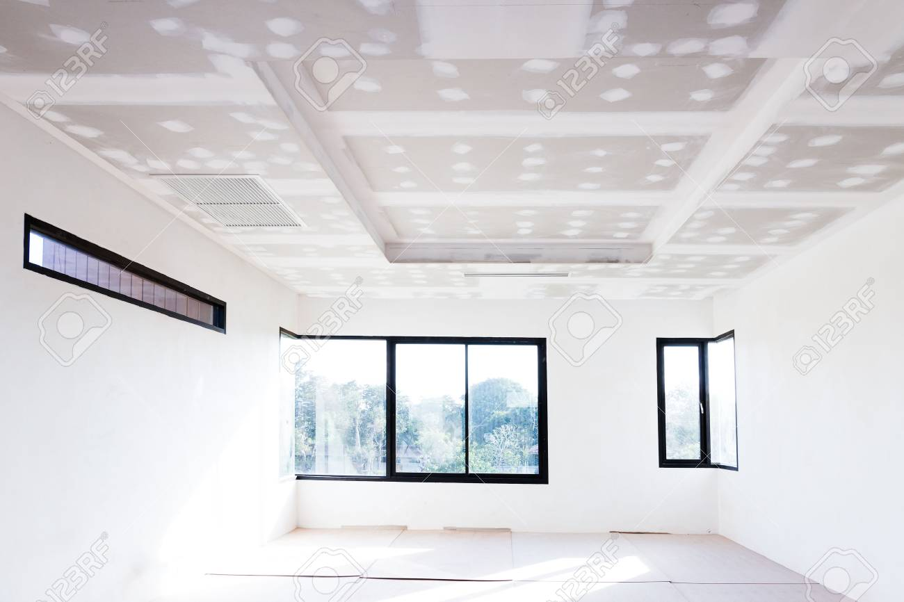 Empty room interior build gypsum board ceiling and Air conditioner in construction site - 65983427