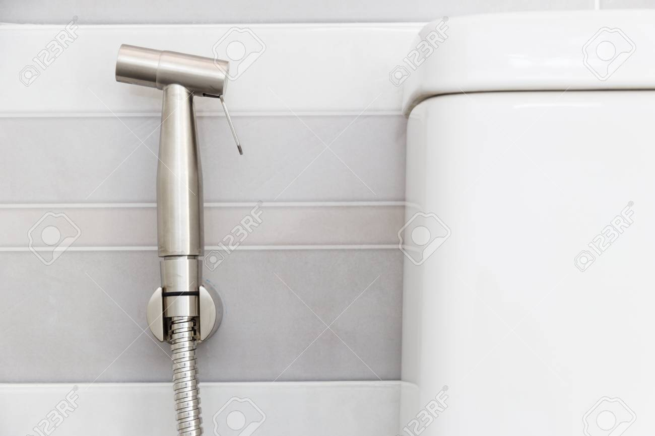 Modern Design Home Bidet Spray Cleaning Flush Toilet In Bathroom Stock Photo