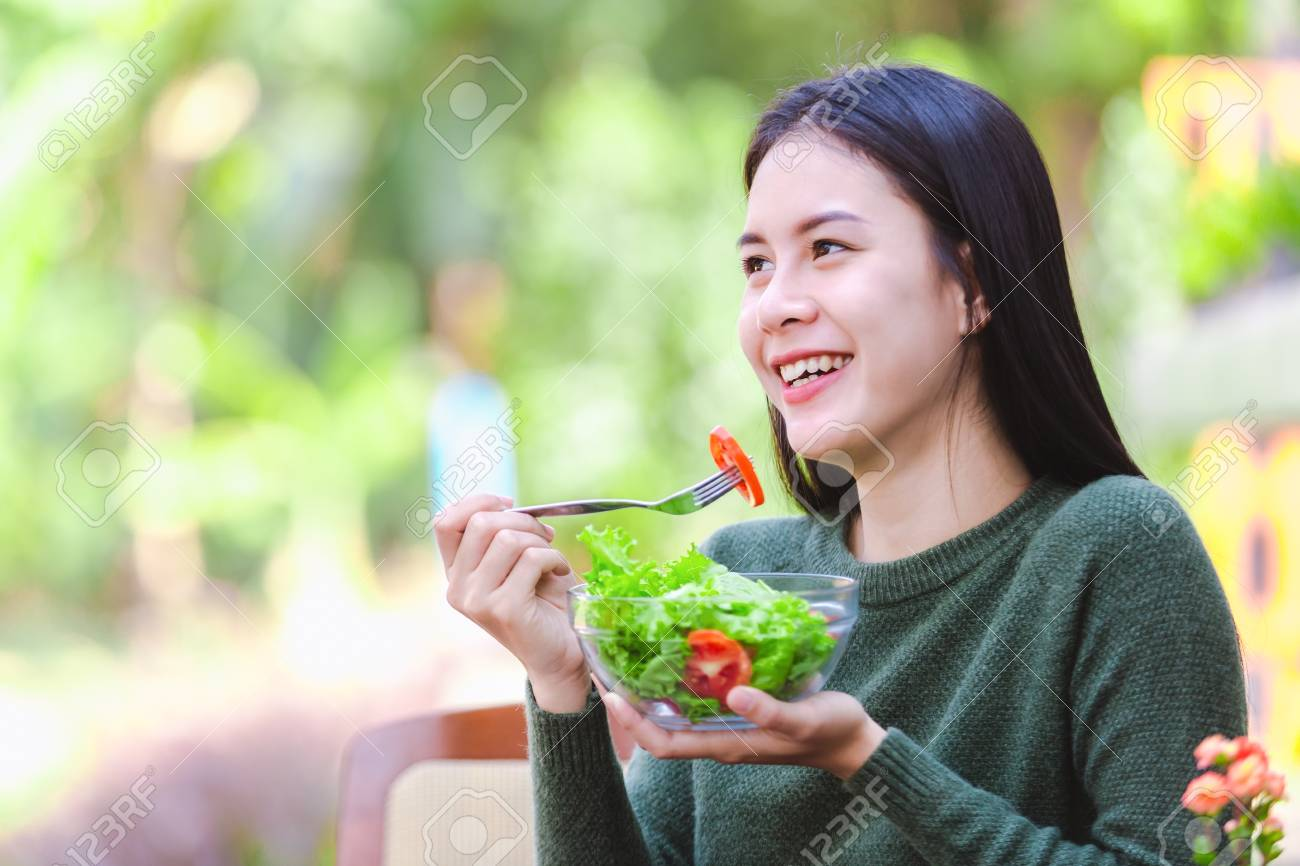 Asian beautiful young girl eating salad vegetable outdoor , Concept healthy body - 122269279
