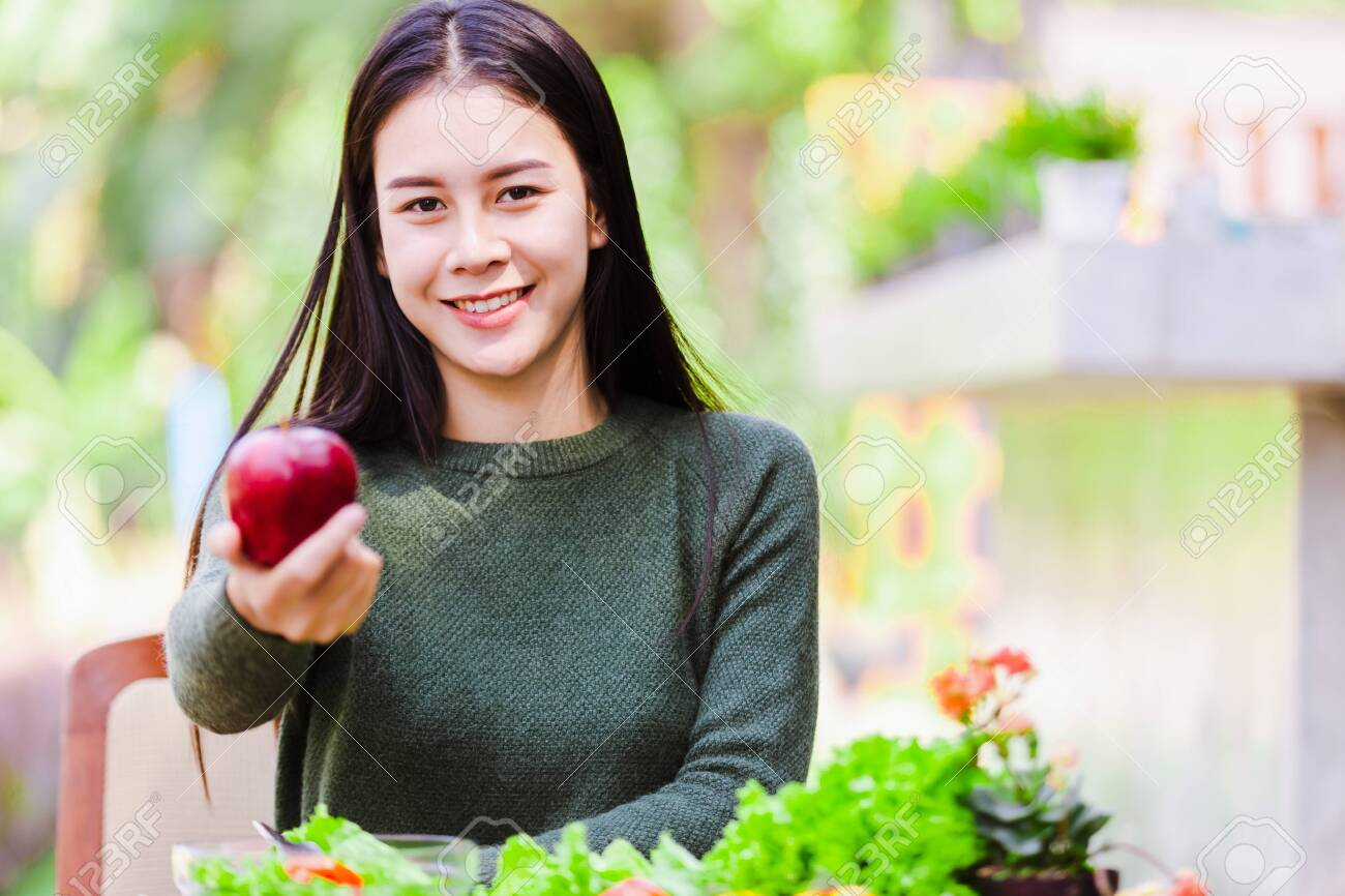 Asian beautiful young girl hold apple and eating salad vegetable outdoor , Concept healthy body - 122269905