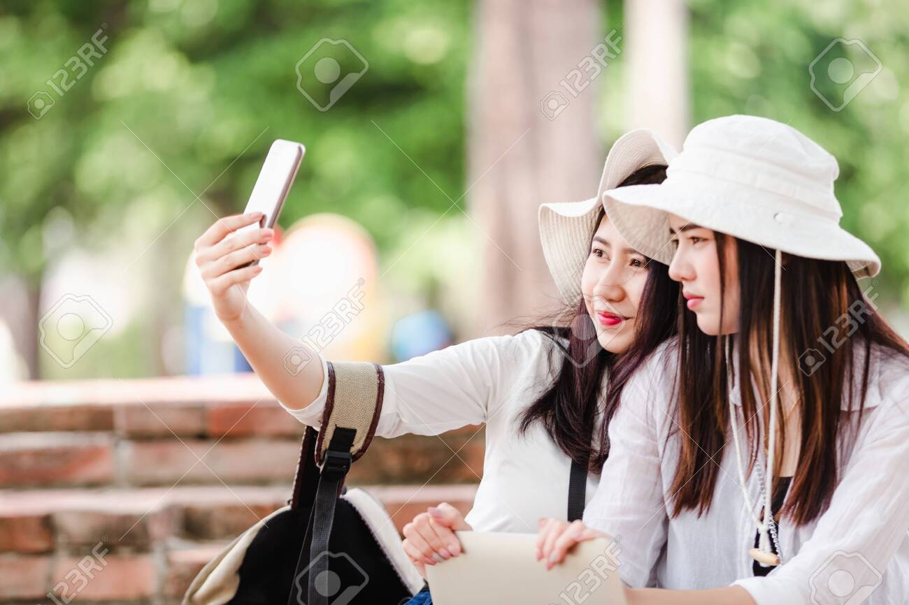 Asian young women tourists taking a selfie in city - 122269910