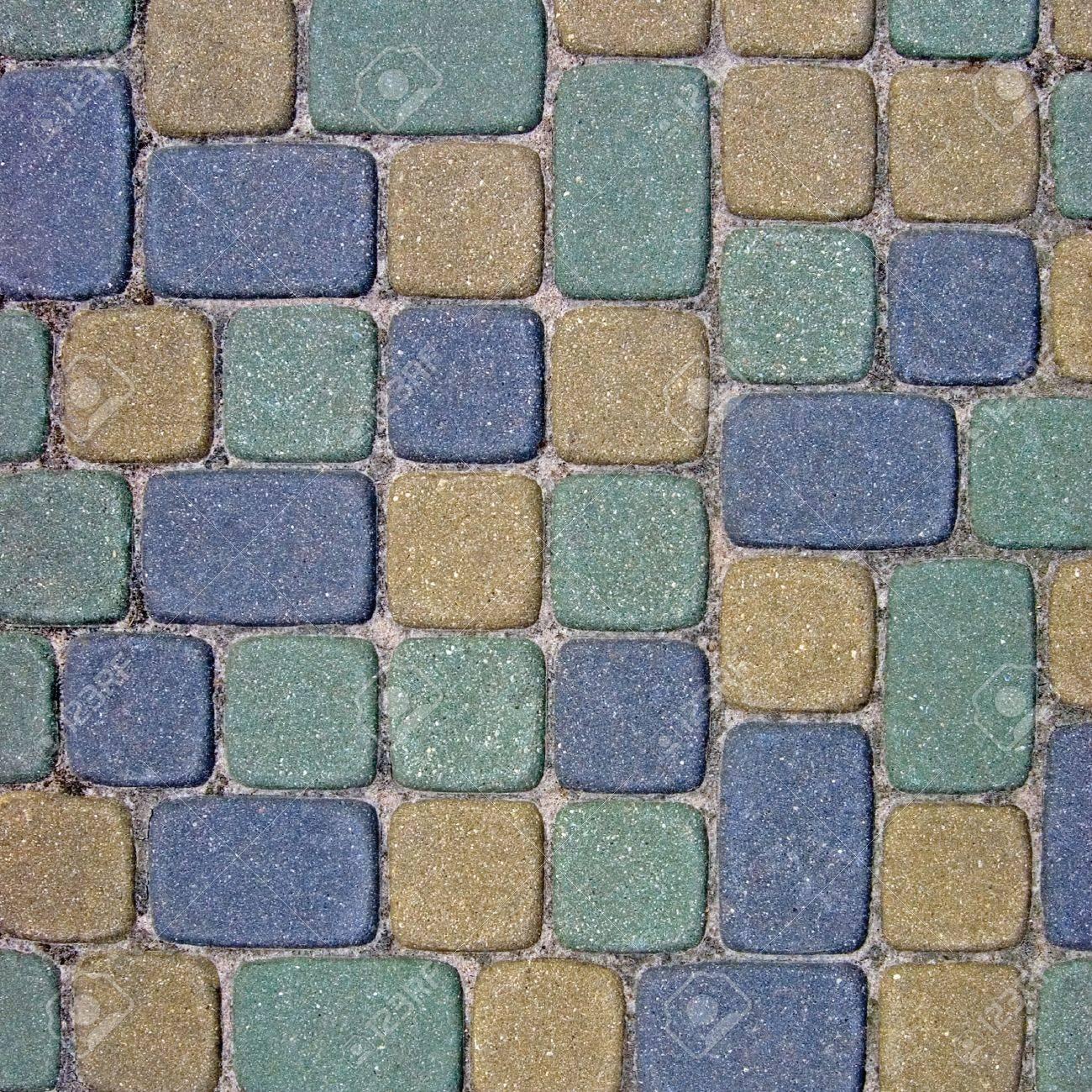 Cobblestone Texture Background Closeup, colorful green, yellow, blue, tan, grey, gray, beige ashlar Stock Photo - 9584310