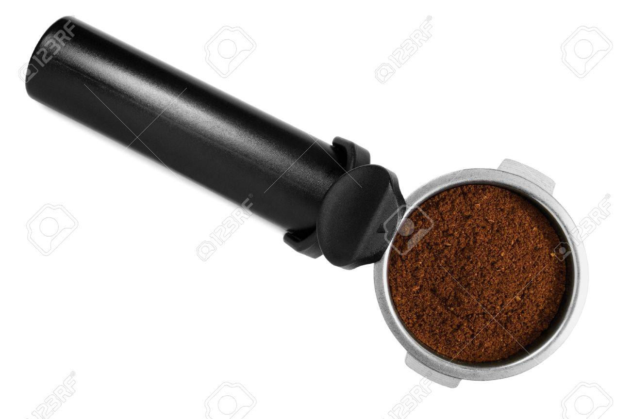 Black stainless steel filter holder, filled with fresh ground espresso coffee, isolated macro closeup Stock Photo - 11830243